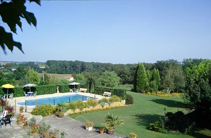 view of pool and garden fron tournesol 2 bedroom gite