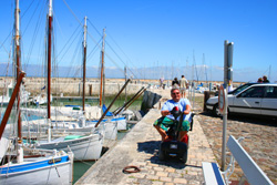 Tate on his mobility scotter at the port of la Flotte