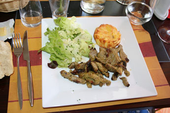 Main course of pork strips with potatoe cake and lettice