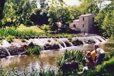 watermill and wier at maison de la riviere